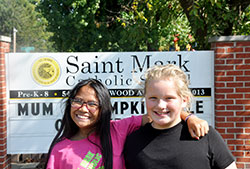 The close friendship of Kho Ti, left, and Sophie Albertson—two sixth-grade students at St. Mark School in Indianapolis—reflects the welcome that Burmese refugees have received in the past five years at St. Mark Parish and its school. (Photo by John Shaughnessy)